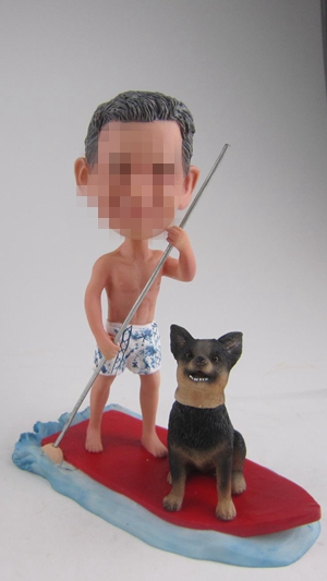 Custom bobbleheads surf with dog